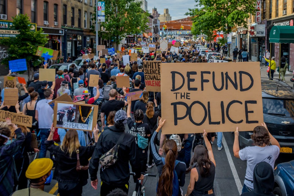 A participant holding a Defund The Police sign at the protest. Thousands of protesters filled the streets of Brooklyn on June 2, 2020, in a massive march to demand justice for George Floyd, killed by Officer Derek Chauvin and to make a loud call for the defunding of the police force. (Photo Erik McGregor/LightRocket/Getty Images)